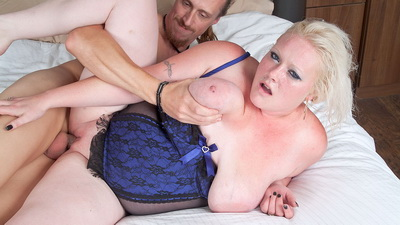 Fat blonde in lingerie seduces a garden worker